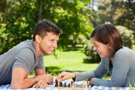 Couple playing chess in the park Stock Photo - 10219684