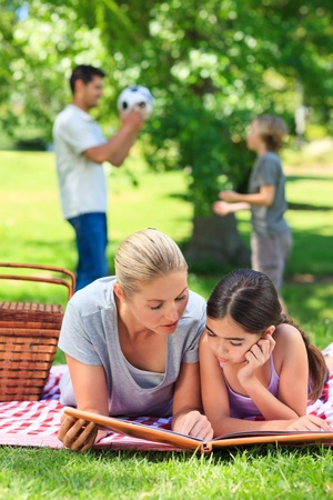 Happy family picnicking in the park Stock Photo - 10218105
