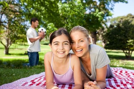 Mother and daughter having fun in the park photo
