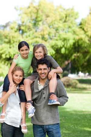 Parents giving children a piggyback Stock Photo - 10219193