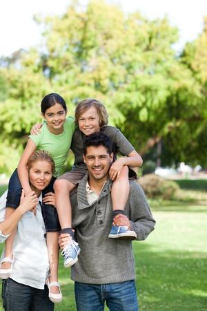 Parents giving children a piggyback Stock Photo - 10219193