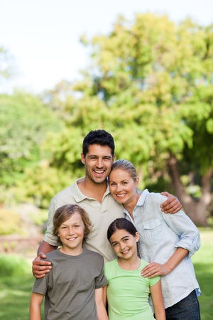 young man portrait: Happy family in the park