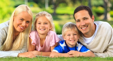 Family lying down in the park Stock Photo - 10217381