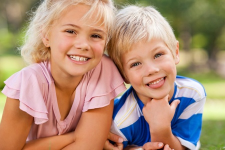 happy moment: Boy with his sister in the park