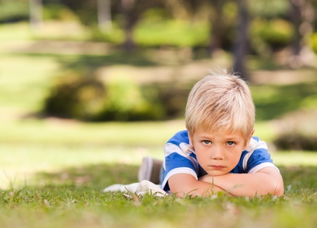cool down: Boy lying down in the park