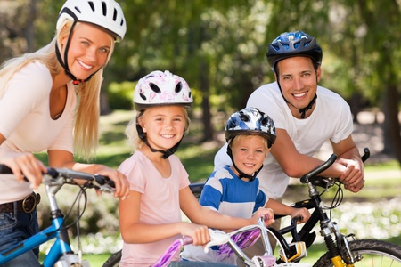 Family in the park with their bikes Stock Photo - 10218127