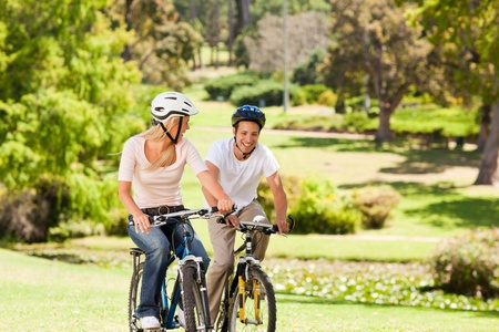 Couple with their bikes in the park Stock Photo - 10218978