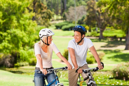 Couple with their bikes in the park Stock Photo - 10217803