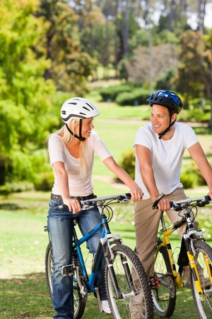 Couple in the park with their bikes Stock Photo - 10219101