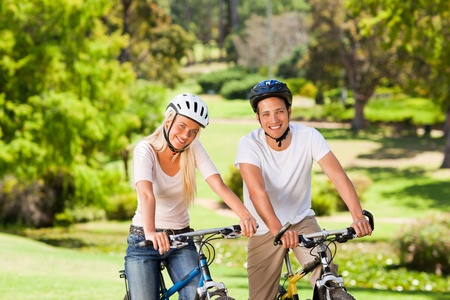 Couple in the park with their bikes Stock Photo - 10217540
