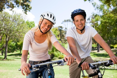 Couple in the park with their bikes Stock Photo - 10219464