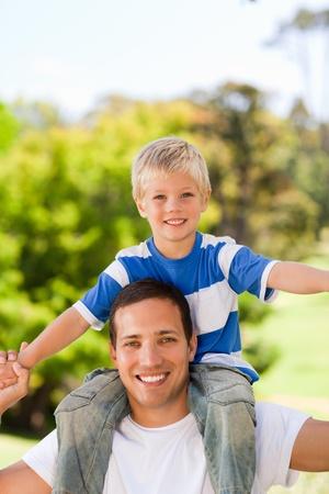 Man giving son a piggyback photo