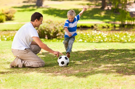 Father playing football with his son photo