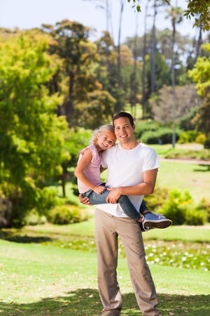 Father with her daughter in the park photo