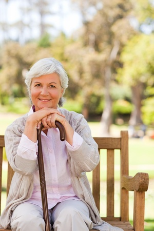 Woman with her walking stick in the park photo
