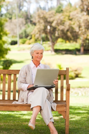 Retired woman working on her laptop photo