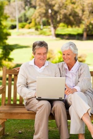 Couple working on their laptop photo