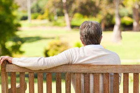 sitting on bench: Senior man on the bench