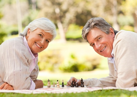 retired couple: Retired couple playing chess
