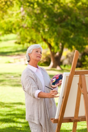 Senior woman painting in the park Stock Photo - 10218621