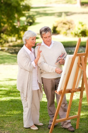 only seniors: Retired couple painting in the park
