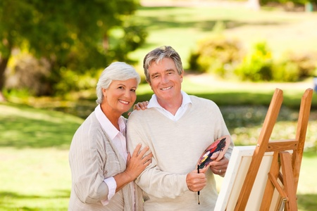 retired couple: Retired couple painting in the park