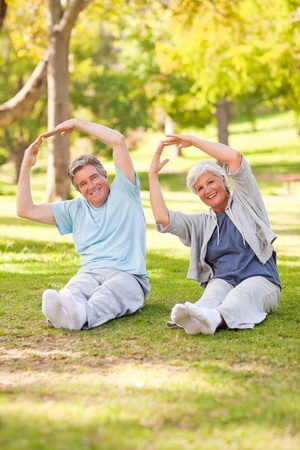 Elderly couple doing their stretches in the park Stock Photo - 10217958