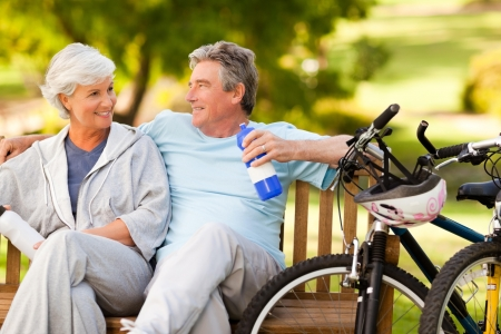 active couple: Elderly couple with their bikes Stock Photo