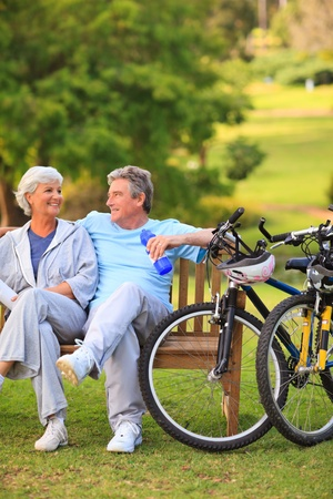 Elderly couple with their bikes photo