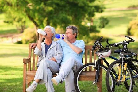 Elderly couple with their bikes photo