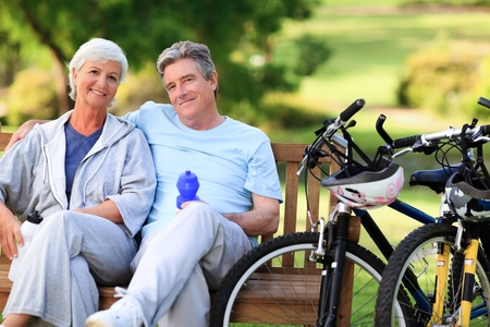 old people having fun: Elderly couple with their bikes Stock Photo