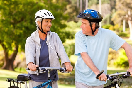 happy old people: Mature couple with their bikes