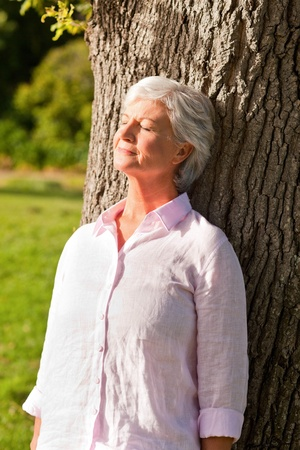 older woman: Senior woman in the park Stock Photo