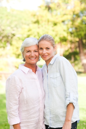 mum and daughter: Mature mother with her daughter Stock Photo