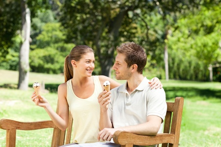 Couple eating an ice cream in the park Stock Photo - 10219201