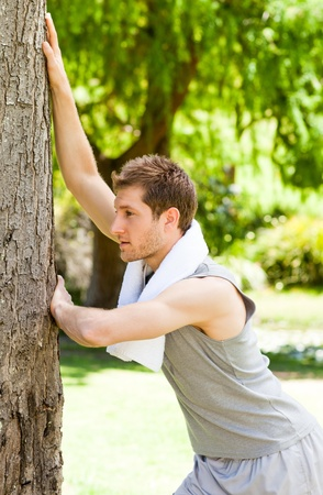 Man doing his stretches in the park Stock Photo - 10217187