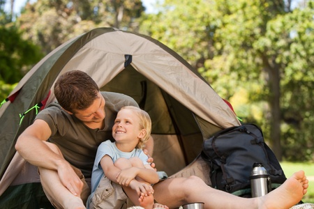 Father and his son camping photo