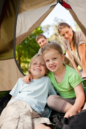 Happy family camping in the park photo
