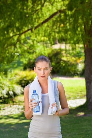 Woman drinking water after the gym Stock Photo - 10217334
