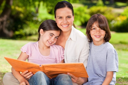 Family looking at their album photo photo