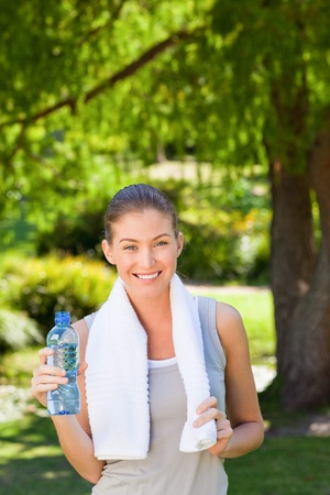 Woman drinking water after the gym photo
