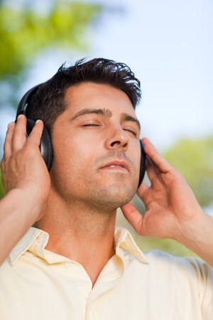 Man listening to music in the park Stock Photo - 10215551