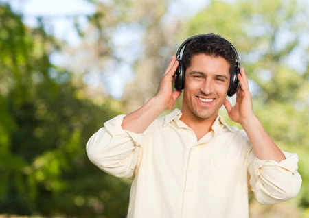 Man listening to music in the park photo
