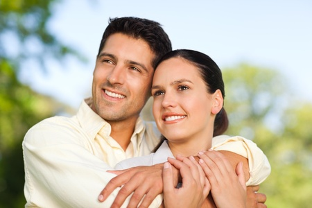 Happy couple in the park Stock Photo - 10214424