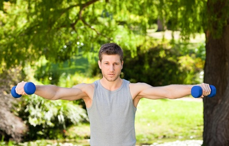 Man doing his exercises in the park Stock Photo - 10216067