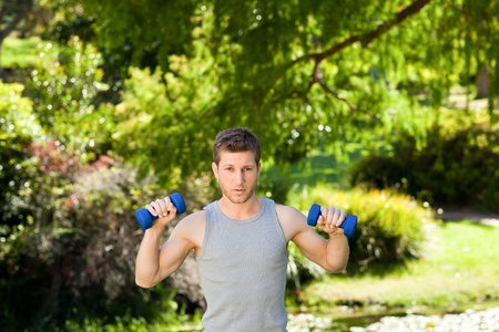 Man doing his exercises in the park Stock Photo - 10217530