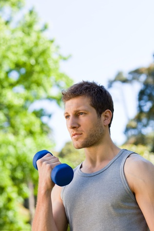 Man doing his exercises in the park Stock Photo - 10216576