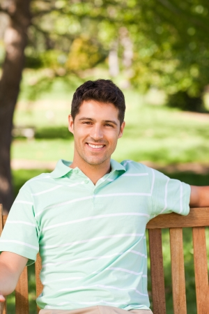 smiling young man: Man on the bench
