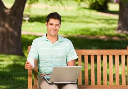 Man working on his laptop photo