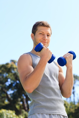 Young man doing his exercises in the park Stock Photo - 10216244